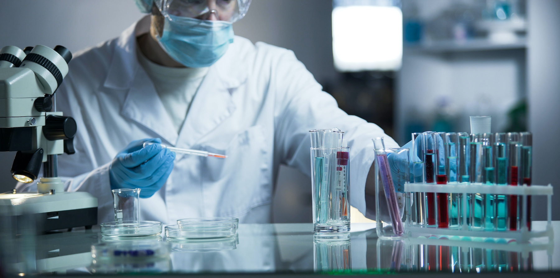 Medical lab assistant taking genetic material for examination